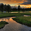 Sunset Over a Creek Jigsaw Puzzle
